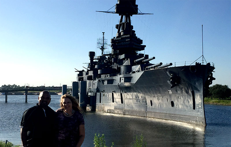 Sam and Lori of Newman Web Solutions standing in front of a battleship in Houston TX